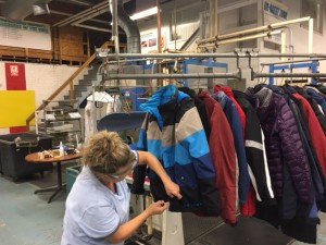 Darla Sturtz of Model Cleaners works on final touches of various Donated Coats in our Model Production Garment Care Center in Charleroi, Pa last week